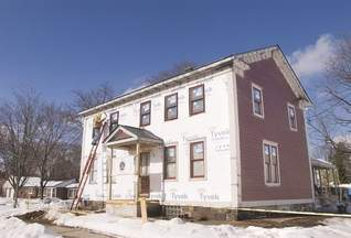 Jimmy Lowe's 1840s Greek Revival farmhouse on Seven Mile Road receives a facelift from Green Building Services to make the building more energy efficient, yet maintain its historical integrity. (Bill Bresler | staff photographer)